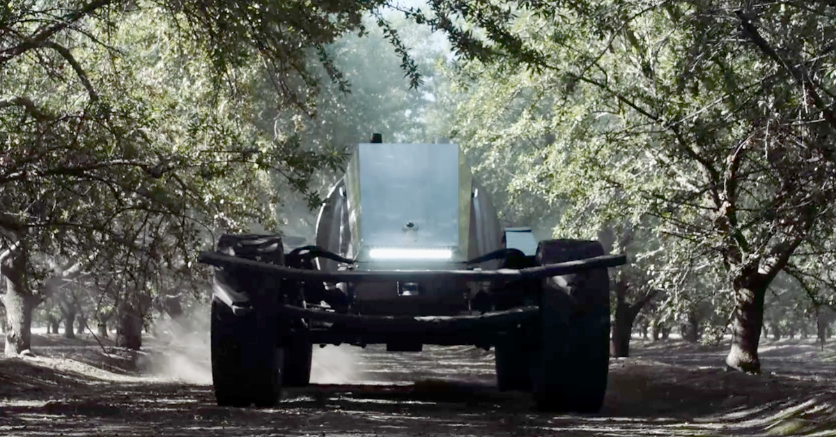 Is the Global Unmanned Spray System (GUSS) an autonomous vehicle, or a robot?